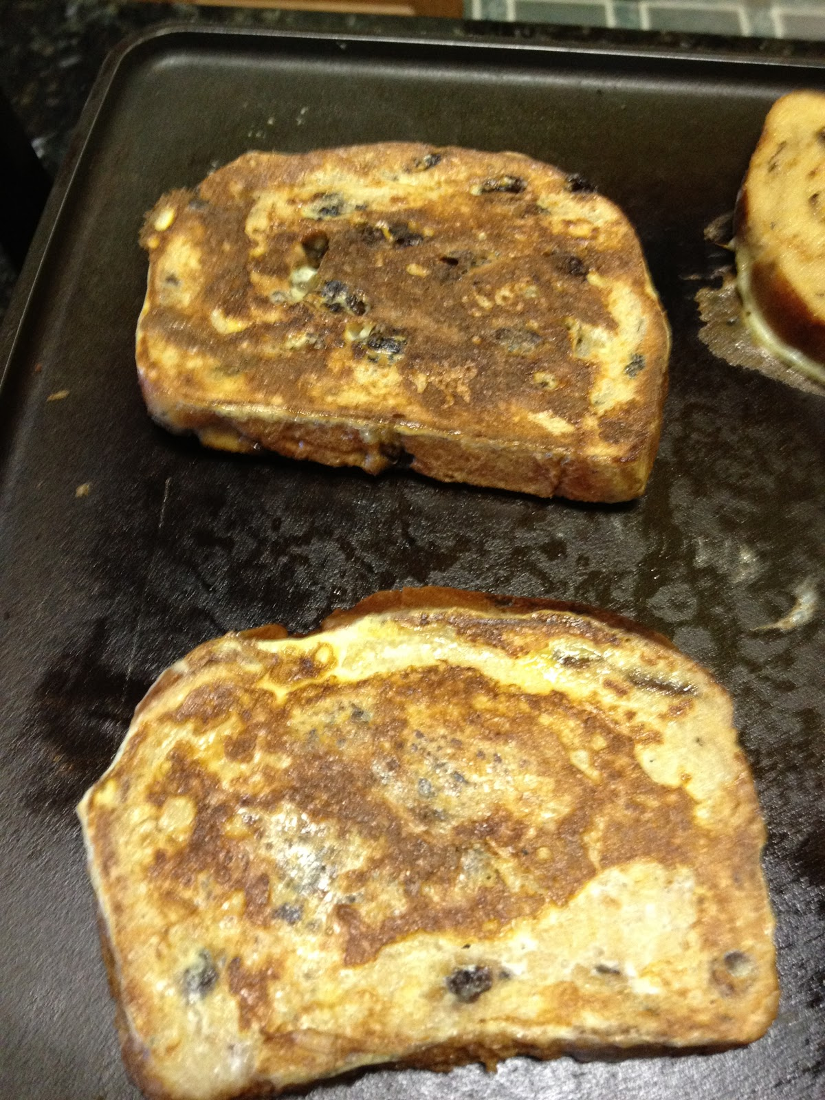 french toast cooking on the griddle